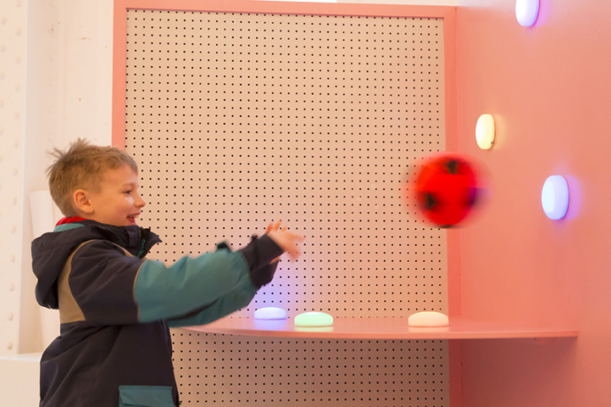 A child interacting with an installation at the imagination Lab