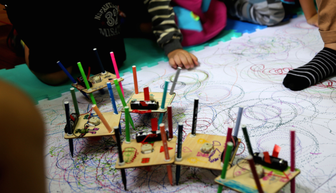 Children with drawing bots